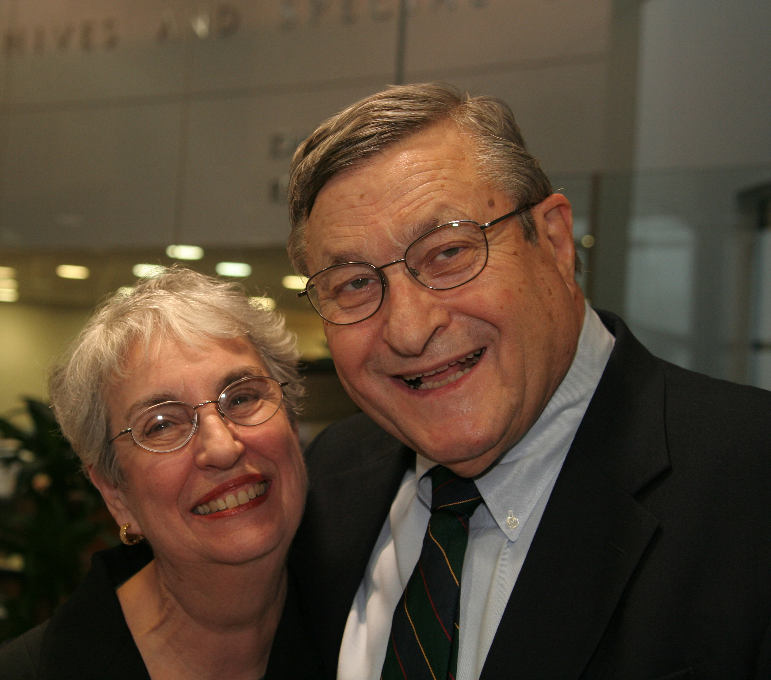 The Parzens smile together at a tribute in their honor