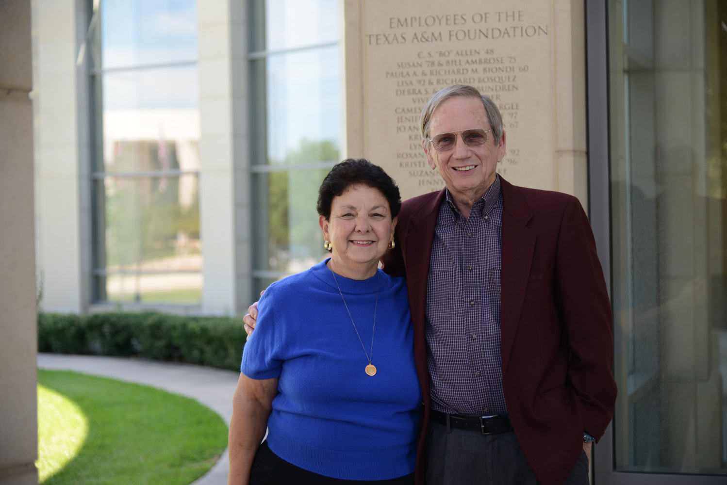 Former students and donors Carolyn '69 and Thomas Adair '57 pose in front of the Hagler Center