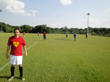 A former chemistry student wears red and white on the soccer field