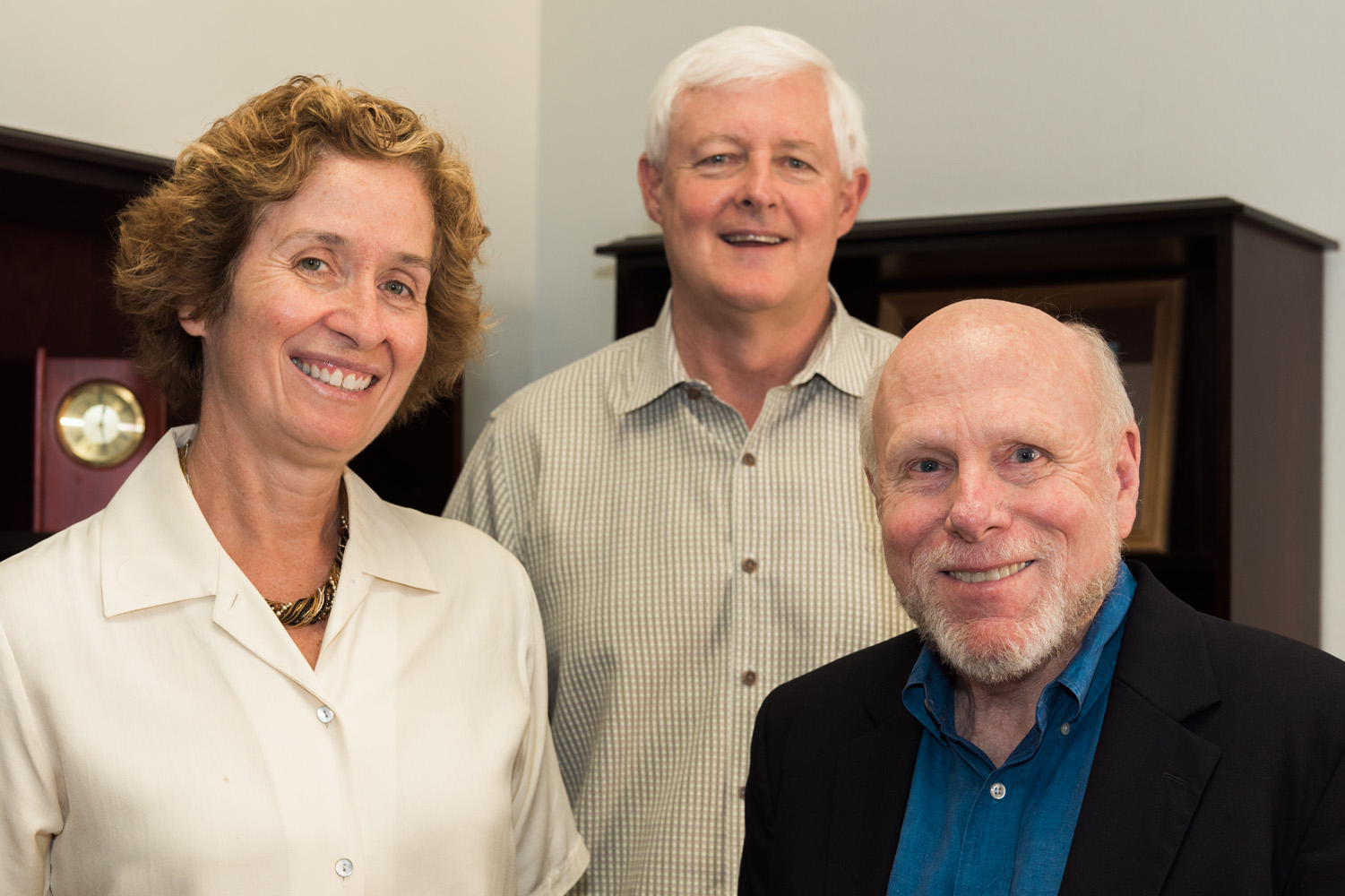 Dean Meigan Aronson and Drs. Valen Johnson and Raymond Carroll smile for the camera