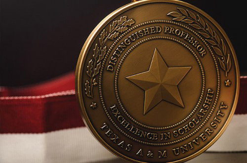 Close up of the gold University Distinguished Professor medal