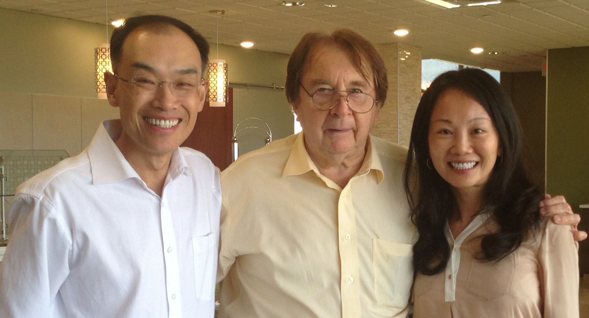 Biologist Tim Hall poses with his former graduate student Eric Xu '93 and his wife, Alice Xu