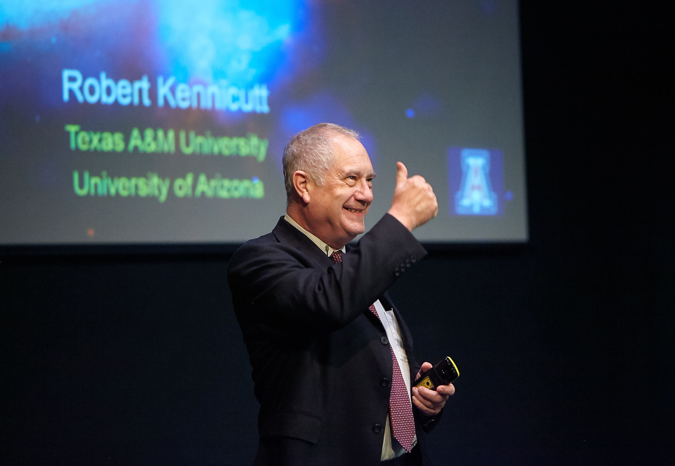 Dr. Robert Kennicutt gives a thumbs up after presenting a HIAS lecture