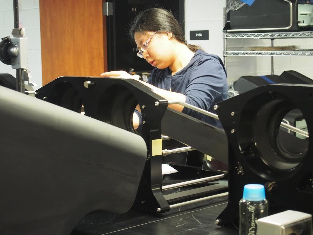 Ting Li conducts an experiment in the lab