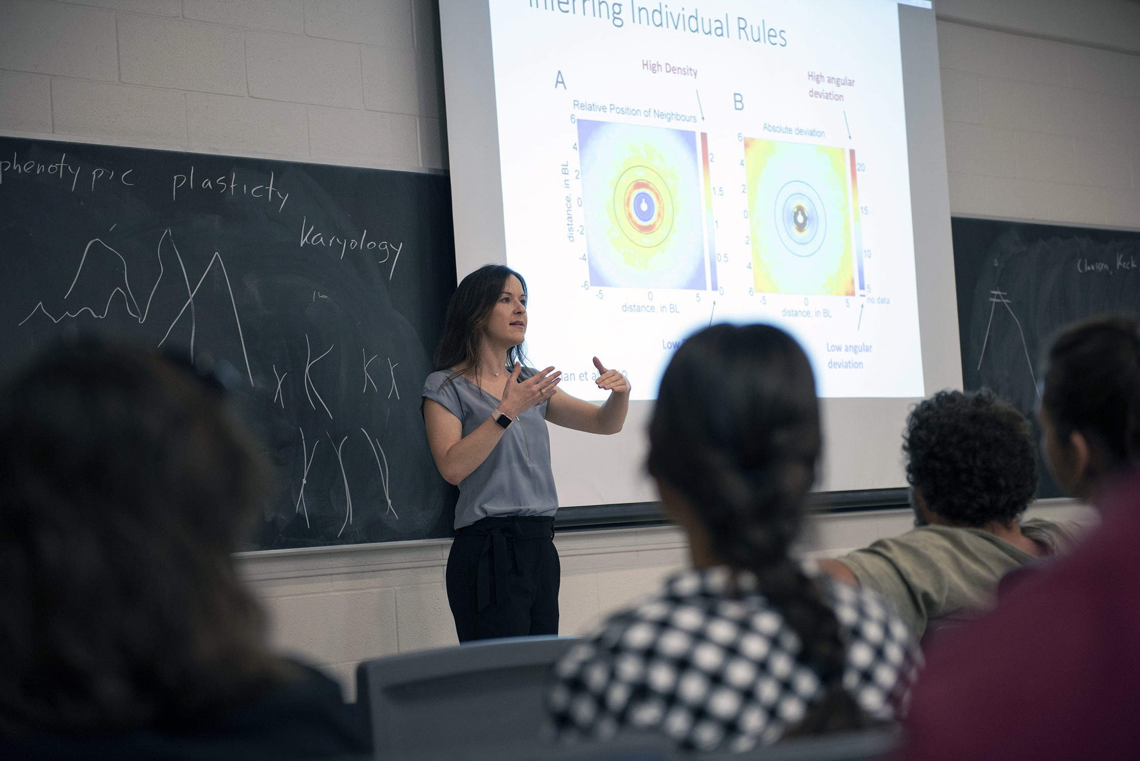 Science graduate student Lisa Bryan lectures to a classroom full of students