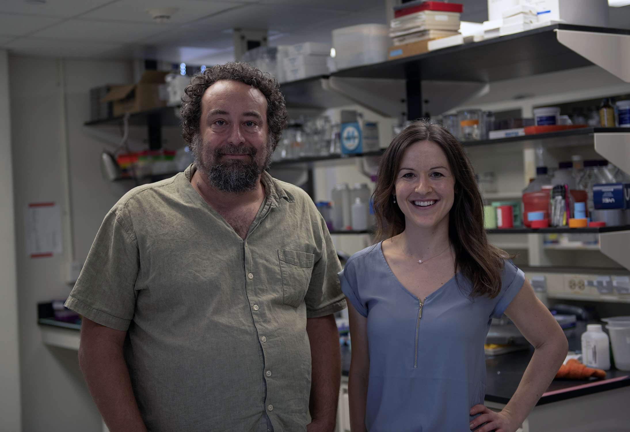 Science graduate student Lisa Bryan smiles alongside Dr. Gil Rosenthal in his lab