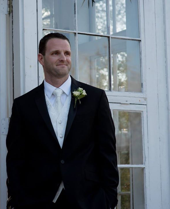 Former chemistry student Matthew Rowan in a tux on his wedding day
