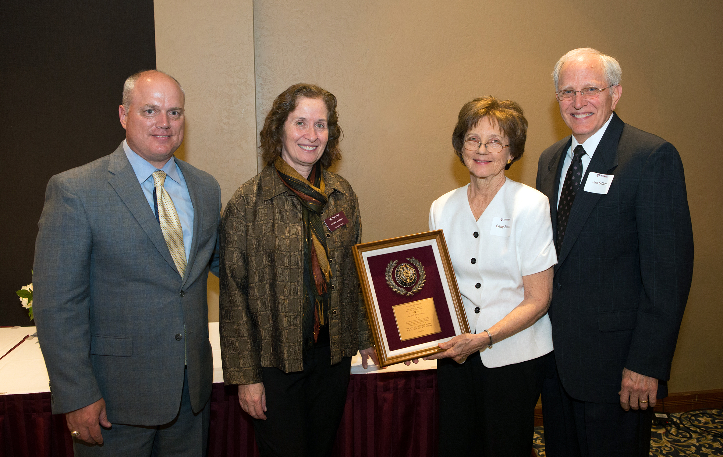 Dean Meigan Aronson and Randy Lunsford award donors with a recognition plaque