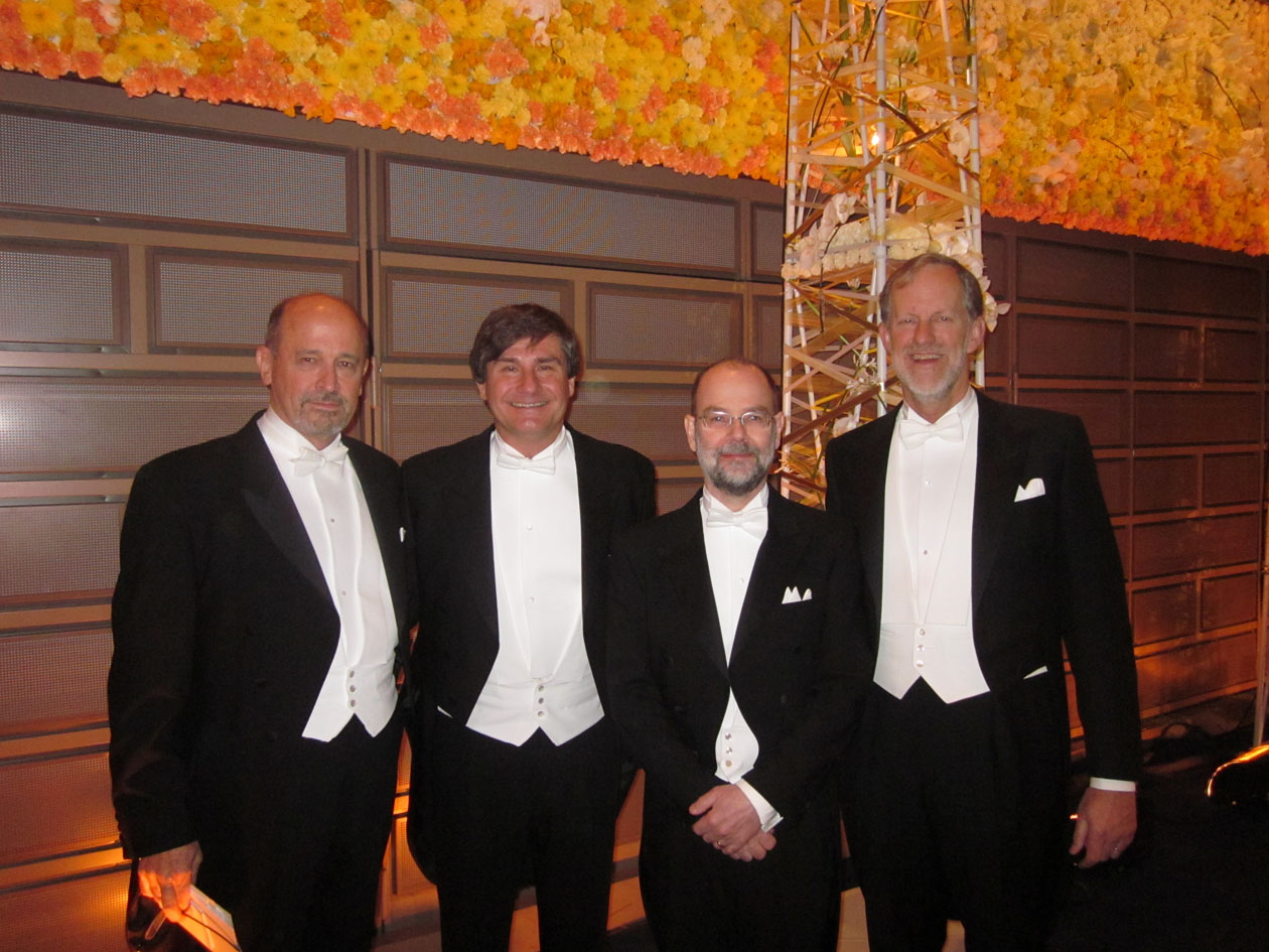 Dr. Nick Suntzeff poses with colleagues in black tie attire