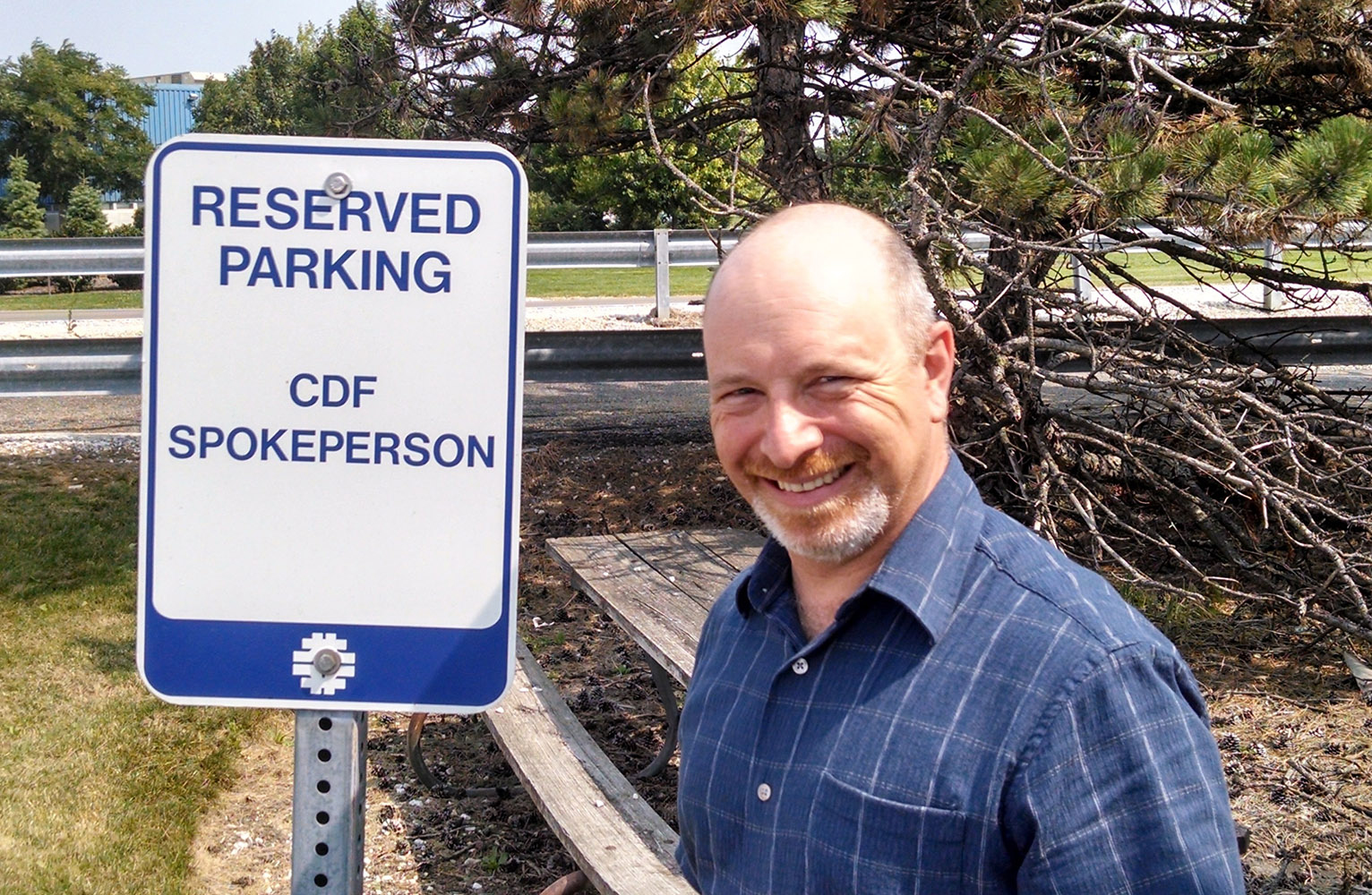 Dr. Dave Toback stands by the Reserved Parking sign for the CDF spokesperson