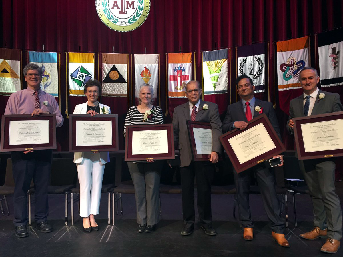 Six science faculty smiling with their 2019 Distinguished Achievement Awards