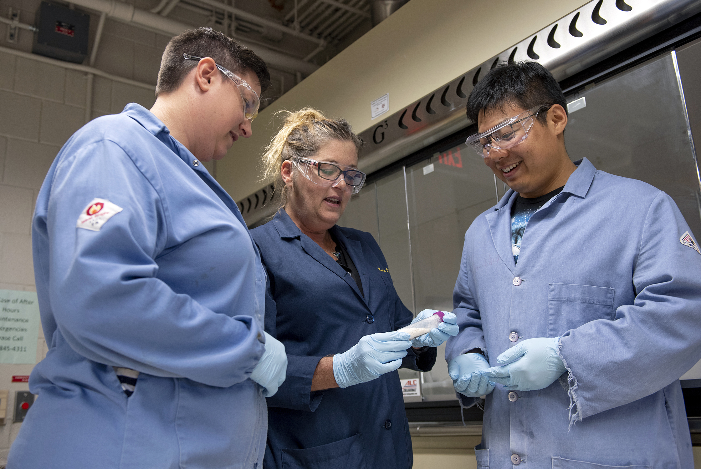 """Texas A&M chemists Ashlee Jahnke, Karen Wooley and Hai """"Peter"""" Wang looking at the chemical basis of what will become a biodegradable polymer."""
