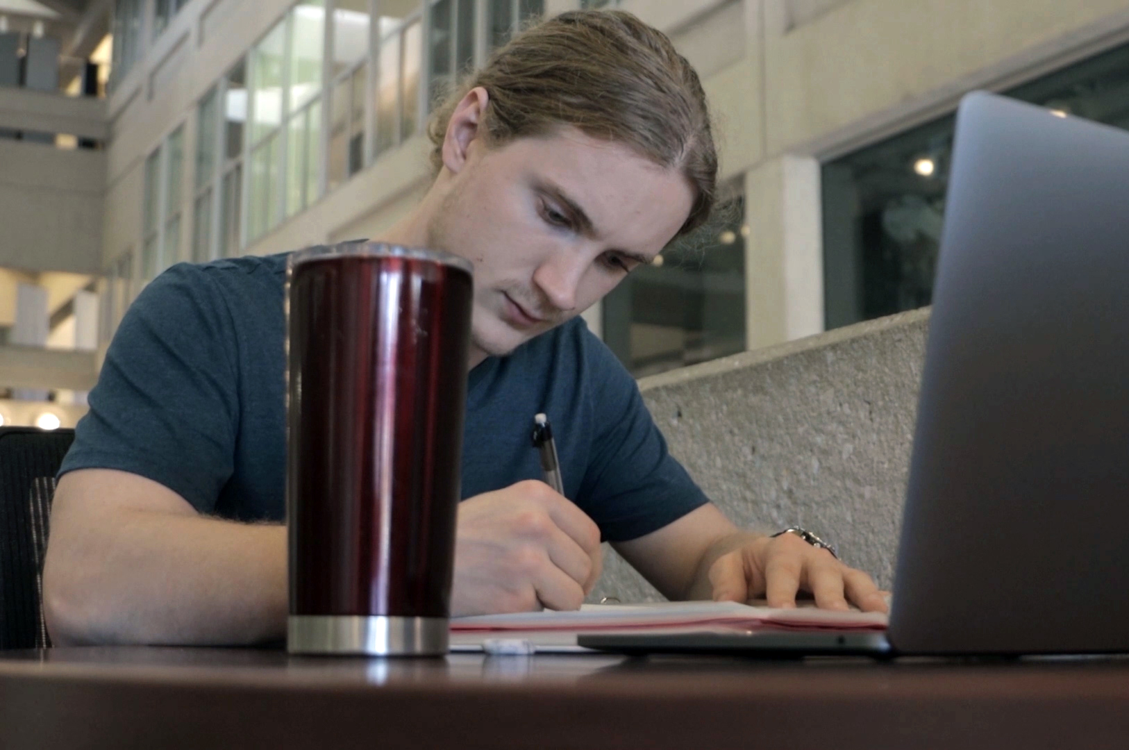 Texas A&M statistics major Alex Peters '21 works on his First Year Eats data analysis project in the first-floor Blocker Building atrium