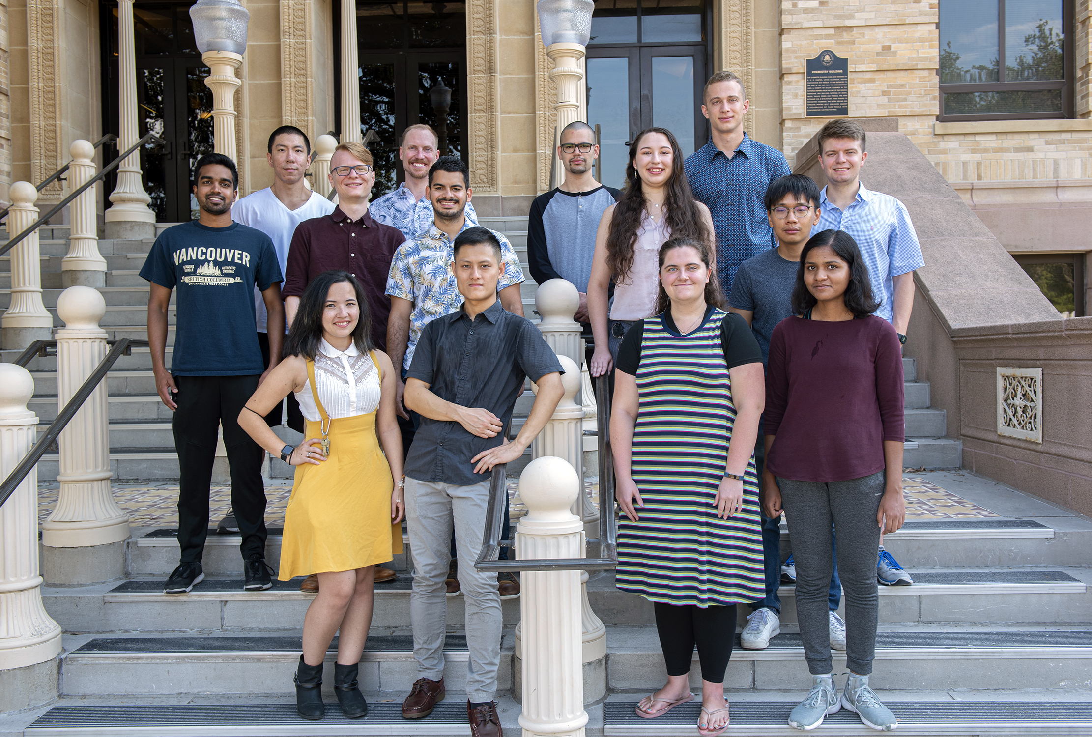 Texas A&M chemist Matthew Sheldon and his research group on the front steps of the Texas A&M Chemistry Building