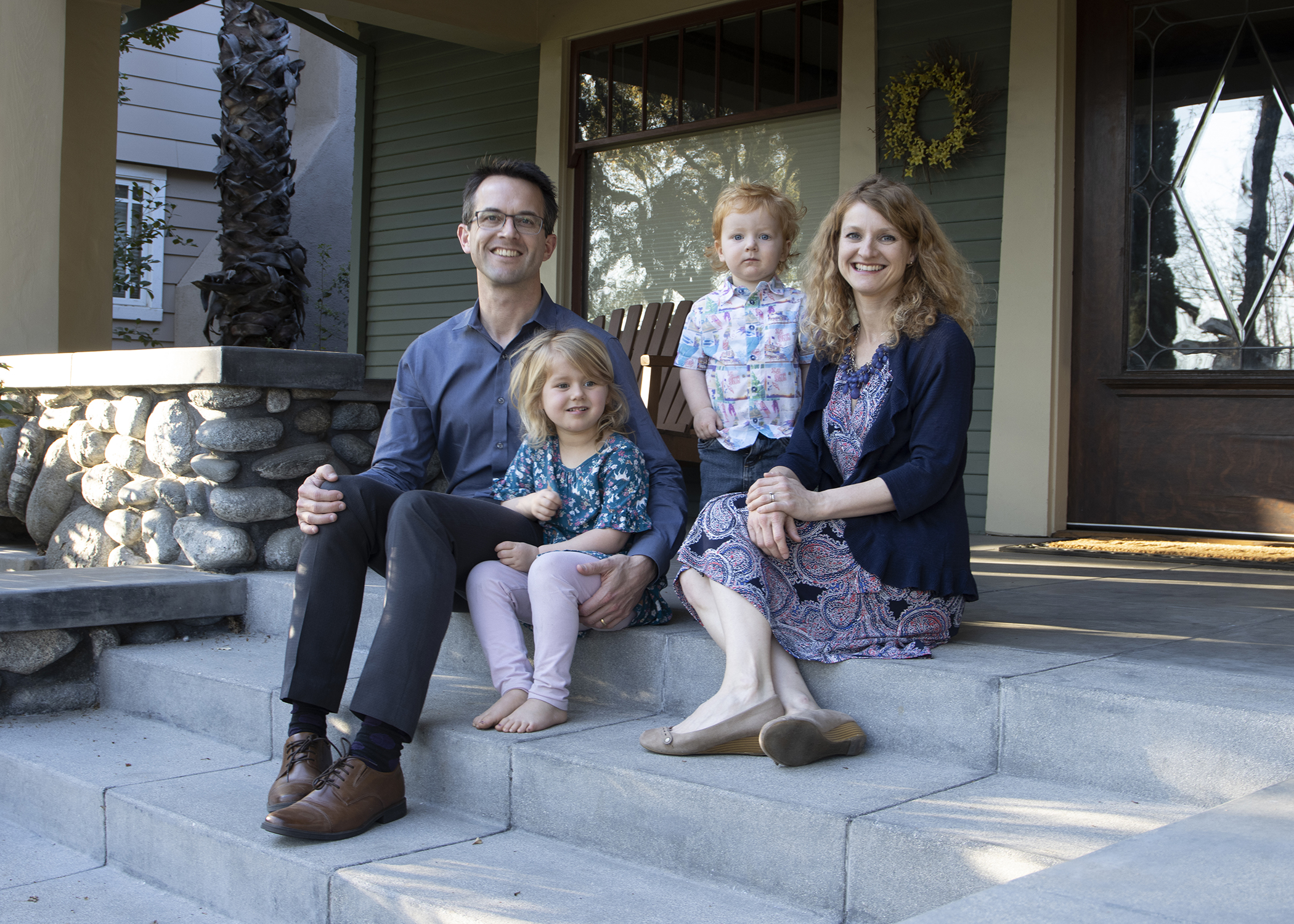 Caltech chemist and 2000 Texas A&M chemistry graduate Dr. Thomas F. Miller III poses on his front porch with his family, daughter Charlotte, son Frankie and wife Nicola