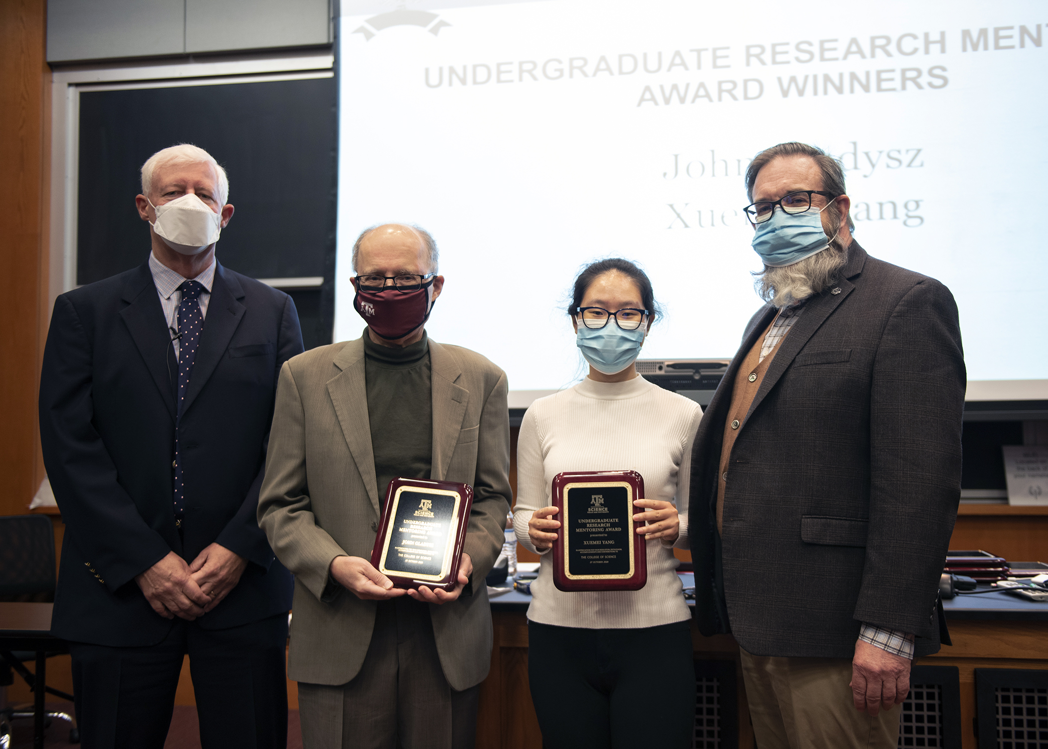 Dean of Science Valen Johnson and Associate Dean for Research Darren DePoy congratulate Texas A&M chemist John Gladysz and chemistry graduate student Xuemei Yang as recipients of the college's 2020 Undergraduate Research Mentoring Awards