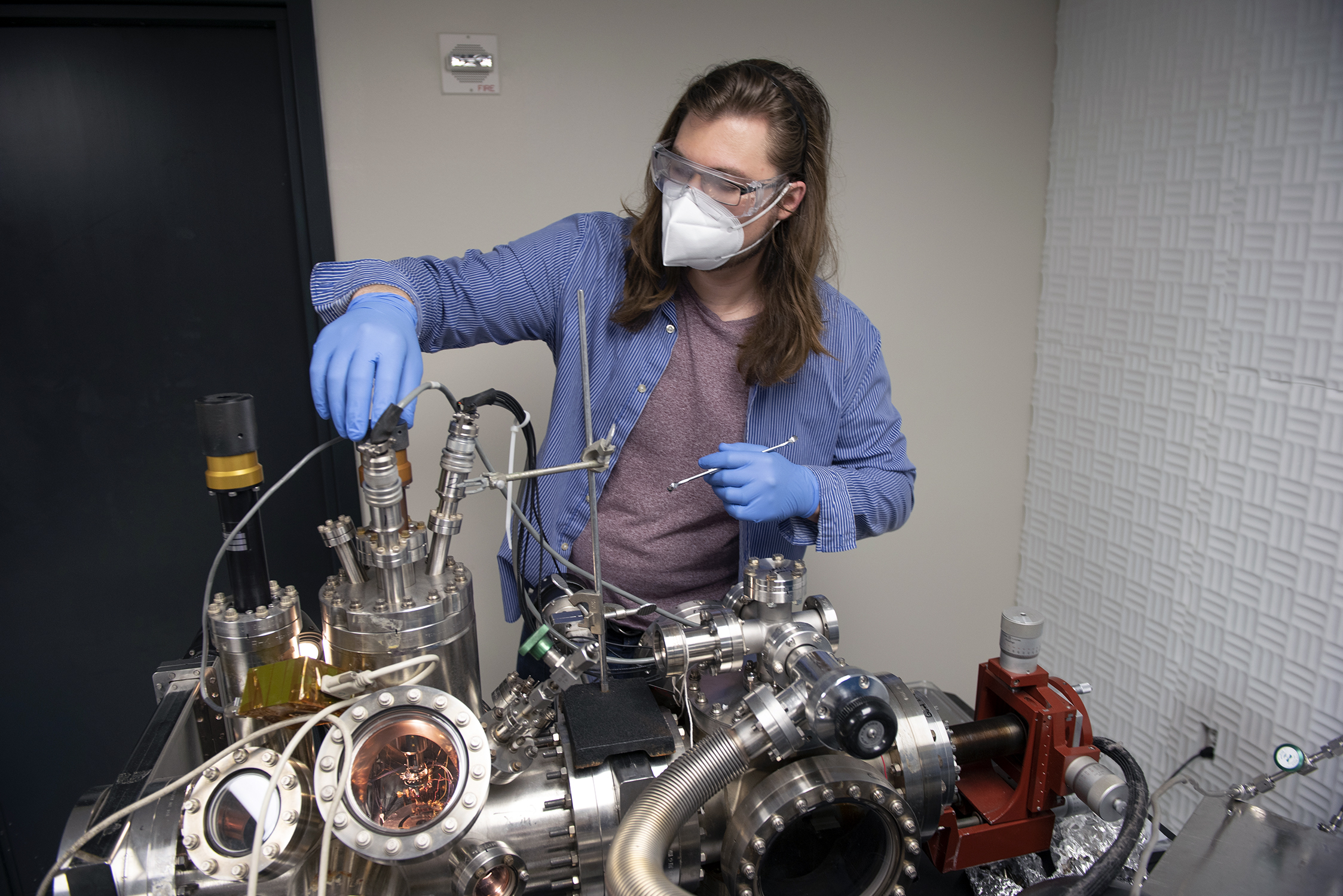 Texas A&M chemistry graduate student Nathaniel Hawthorne, working on force-driven reactions on graphene within the Batteas Laboratory